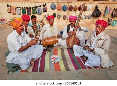 JODHPUR, INDIA - JAN 28: Street musicians play music on different traditional instruments outdoor on January 28, 2015 in Rajasthan. Jodhpur with population 1,290,000 people, is center of Marwar region