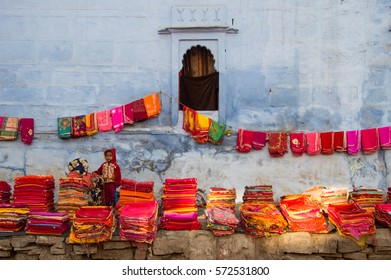 JODHPUR, INDIA - JANUARY 01, 2017: the blanket shop next to the blue wall of the blue city of Jodhpur