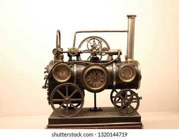 Jodhpur, India - January 2019 : A vintage collectible table clock in the shape of a train.