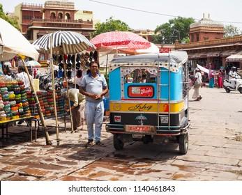 Jodhpur , India - June 2,2018 Indian Man Standing Near TukTuk Car at Jodhpur Market.