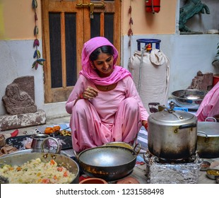 Jodhpur, India - Nov 6, 2017. Women cooking Indian traditional meal in Jodhpur, India. Jodhpur is the second largest city in state of Rajasthan.