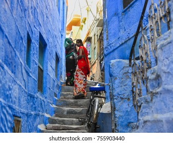 Jodhpur, India - Nov 7, 2017. Women walking at Blue Town in Jodhpur, India. Jodhpur is a popular tourist destination, featuring many palaces, forts and temples.