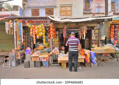 Jodhpur, India - November 06, 2017: A man buying items from a roadside stationery shop.