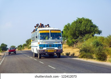 JODHPUR, INDIA - OCTOBER 23: people travel by bus in Jodhpur on October 23, 2012. Unsatisfactory quantity & quality of public transportation limit people in everyday traveling.