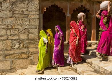 Jodhpur, India-November 1, 2017 :Traditionally dressed unidentified Indian women carry ceramic pot in a step-well in Balara village near Jodhpur.