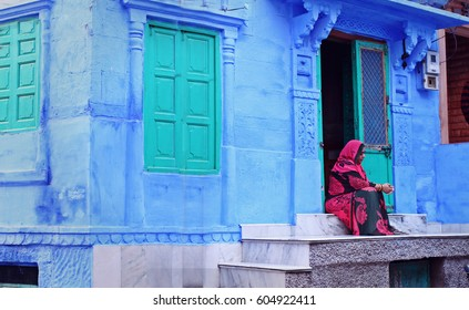 JODHPUR - JANUARY 08: A daily street scene from the Blue City Jodhpur on January 08, 2017 in Jodhpur, India. Most houses are painted blue in this zone and hence it has got this name by the travelers.