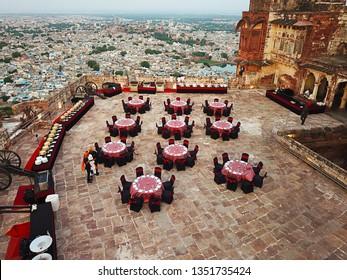 JODHPUR, RAJASTHAN, INDIA , AUGUST 08, 2018 : Aerial view of royl dining setup in the evening at mehrangarh fort, jodhpur rajasthan, heritage property, travel, destination wedding - Image