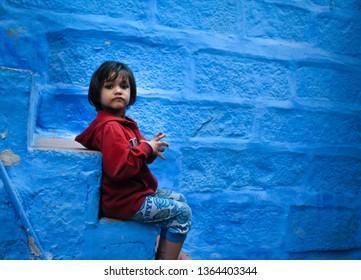 Jodhpur, Rajasthan, India - Dec 28, 2018. children sitting at stairs in blue city, jodhpur, India.