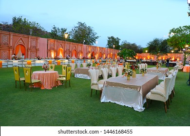 Jodhpur, rajasthan, india - May 18th, 2018: luxurious Long dinner tables and chairs, rich decorated with flowers in the garden , Indian Wedding arrangement setup - Image