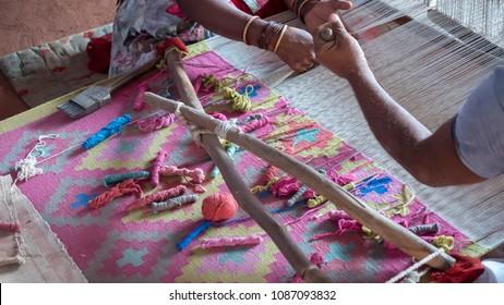 Jodhpur Rajasthan, India : October 8, 2017 - Village Weaver weaving Rug by Hands in India