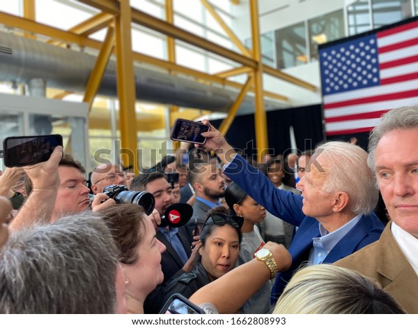 Joe Biden takes a selfie with one of his supporters at rally in Houston, Texas on March 2, 2020