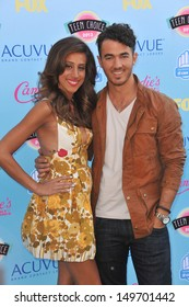 Joe Jonas & date at the 2013 Teen Choice Awards at the Gibson Amphitheatre, Universal City, Hollywood. August 11, 2013  Los Angeles, CA