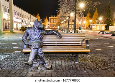 "Joensuu, Finland - October 25, 2019: Sculpture ""The Courting Wolf"" - the most photographed landmark in Joensuu against autumn trees."