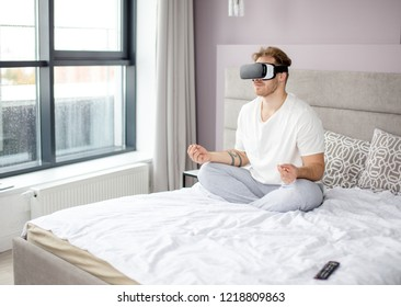 joga with virtual reality. side view photo. technology, sport concept. relaxation. unusual hobby, activity