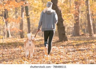 Jogger and akita dog outdoors