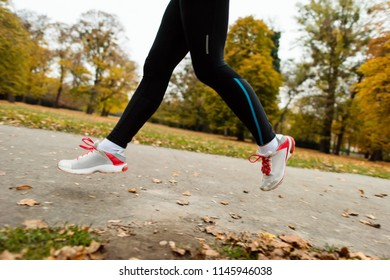 Jogger - Focus on running shoes of a woman.