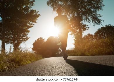 Jogger runs in the evening sun
