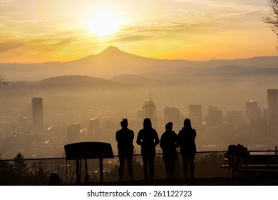 Joggers taken in the view after reaching Pittock Mansion