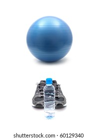 Joggers, water and a fitball isolated against a white background