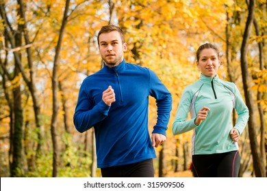 Jogging couple - young man and woman competing, man first