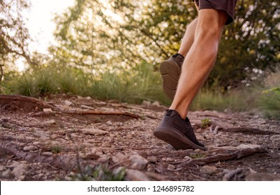 jogging during sunset in a mountain path