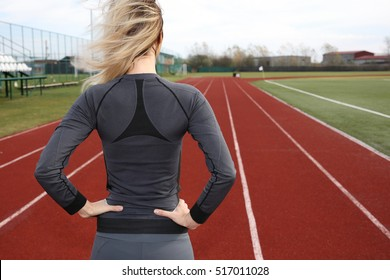Jogging, sport concept. Fitness woman workout outdoors cold winter day. Cold weather training, no excuse, sport, fitness, active lifestyle
