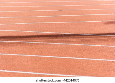 Jogging in a stadium with markings