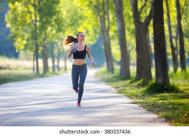 Jogging woman with a bottle of water