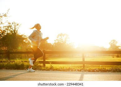 Jogging woman running in park