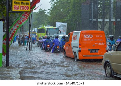 JOGJA NOVEMBER 28, 2017: A big flood that hit the city of Jogja, one of which is in the southern region precisely on Jalan Parangtritis. This causes a long jam.