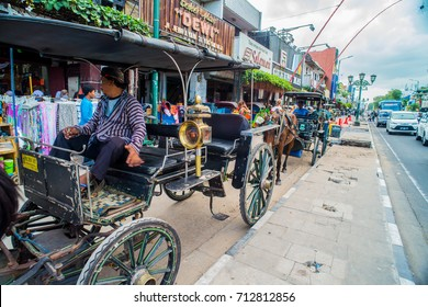 JOGJAKARTA- August 5: horse drawn carriage in the streets of Jogjakarta on August 5, 2017 in Jogjakarta, Indonesia. Horse drawn carriages are popular method of transportation here.