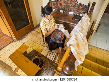 Jogjakarta, Indonesia (08/25/2015) : A Batik artist in process of making traditional textile of Indonesia, Batik. It is a handmade process to make batik pattern in the textile material.