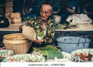 Jogjakarta / Indonesia - July 24, 2016 : an old woman gudeg seller. Her name is Mbok Lindu one of the famous gudeg seller in Jogjakarta.