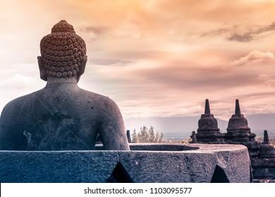 Jogjakarta/Indonesia-Dec 15 2016: A statue of Buddha at the Borobudur Temple in Jogjakarta, Indonesia.
