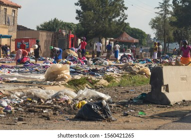 Johannesburg - April 10, 2018:  a clothing street market outdoors where poor African people are laying out their garments for sale, exchange, barter, trade or swap with others in urban South Africa