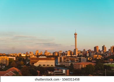 JOHANNESBURG, CIRCA 2018: The Johannesburg skyline and the Hillbrow Tower glow in the afternoon sun in Johannesburg, South Africa, circa 2018.