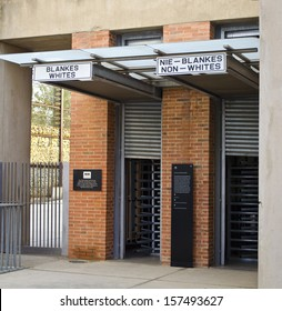 JOHANNESBURG - FEBRUARY 28: Apartheid Museum entrance stands on February 28, 2013 in Johannesburg. The entrances are split between whites and non-white.