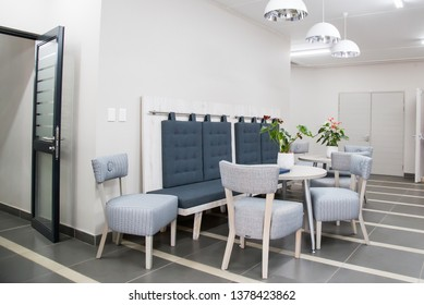 Johannesburg Gauteng South Africa 04122019 interior clean design with grey chairs and white