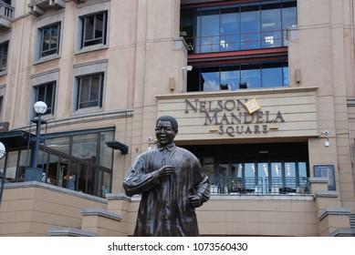 Johannesburg, Gauteng / South Africa - August 2013: The statue of former president Nelson Mandela in Nelson Mandela Square in Sandton