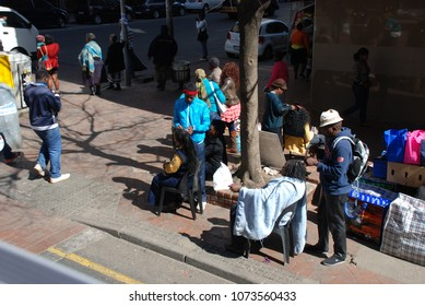 Johannesburg, Gauteng / South Africa - August 2013: People having their haircut in the street in downtown Joburg