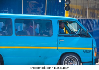Johannesburg , Gauteng / South Africa -August 02 2018 : african taxi full of passengers stopped on the side of the road waiting Rosettenville Johannesburg