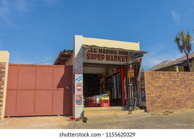 Johannesburg , Gauteng / South Africa -August 02 2018 : front of a spaza shop on the sidewalk midday Rosettenville Johannesburg