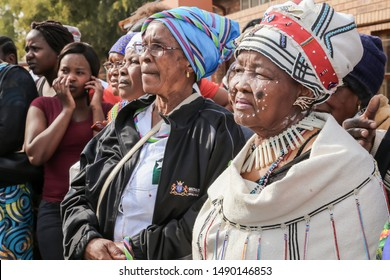 Johannesburg, Gauteng, South Africa August 09 2019 Black ethnic woman standing in a crowed covid-19 corona virus pandemic township epidemic lockdown quarantine epicentre