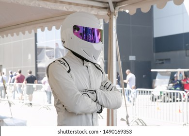 Johannesburg, Gauteng, South Africa August 25 2019 The stig top gear at race track with arms folded in a white racing suit with helmet outside