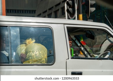 Johannesburg, Gauteng / South Africa - October 03 2018 : taxi driver and a passenger at the back midday Johannesburg CBD