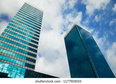 Johannesburg , Gauteng / South Africa - September 11 2018 : tall buildings reflecting the blue sky and clouds midday johannesburg cbd