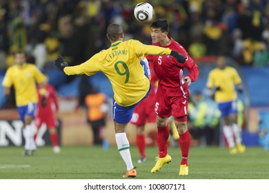 JOHANNESBURG - JUNE 15:  Luis Fabiano of Brazil (l) and  Kwan Chong Ri of North Korea (r) battle during a World Cup match on June 15, 2010 in Johannesburg, South Africa.