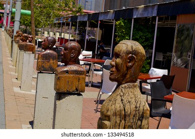 JOHANNESBURG - MARCH 01: Wooden heads on stand on plinths in Newtown on March 01, 2013. The artists intended these heads to reflect the faces African diversity.