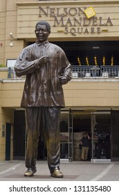 JOHANNESBURG - MARCH 10: Bronze statue of Nelson Mandela stands on March 10, 2013 in Johannesburg.  Nelson Mandela is credited with peacefully leading South Africa across the apartheid divide.