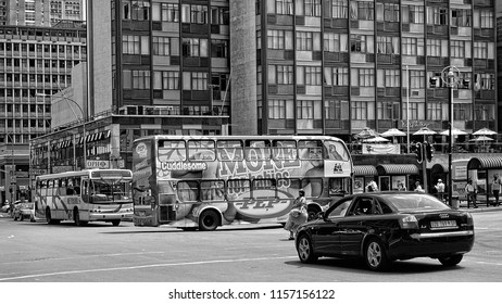 Johannesburg. Megalopolis. Urban traffic, transport, buildings and city infrastructure. City life. Black and White Photography. Johannesburg, South Africa - December 21, 2013